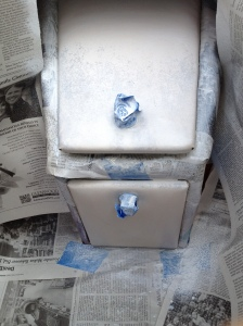 taped and masked glove box of boat with primer coat