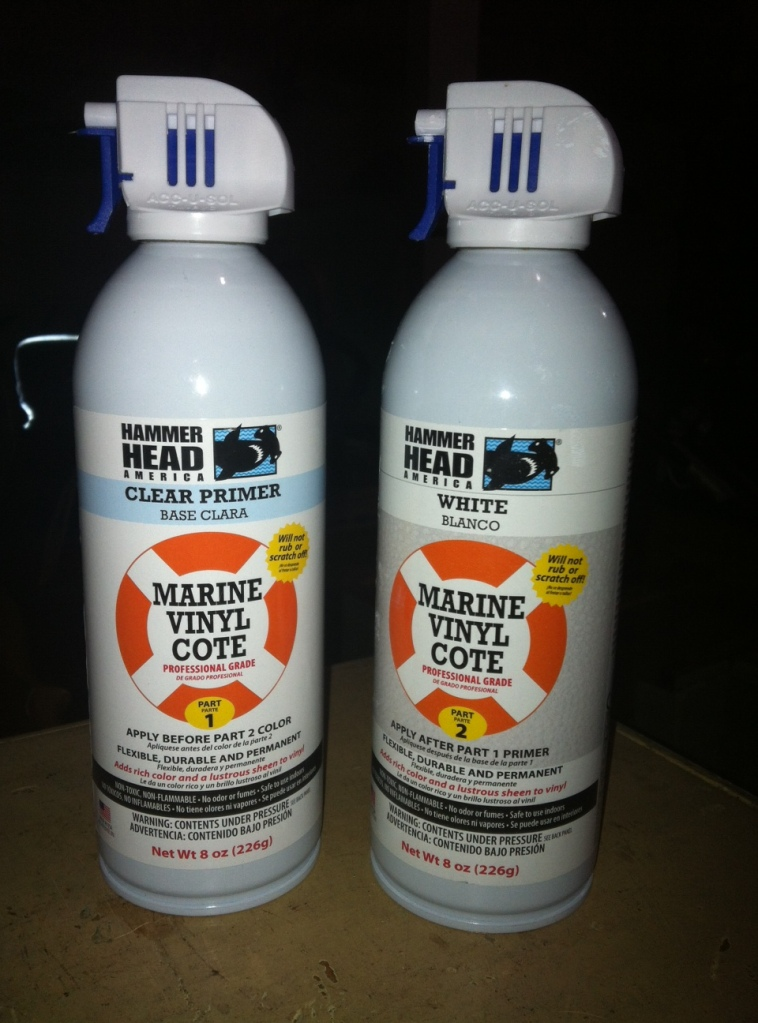 can of primer and can of color of spray paint designed for marine vinyl applications